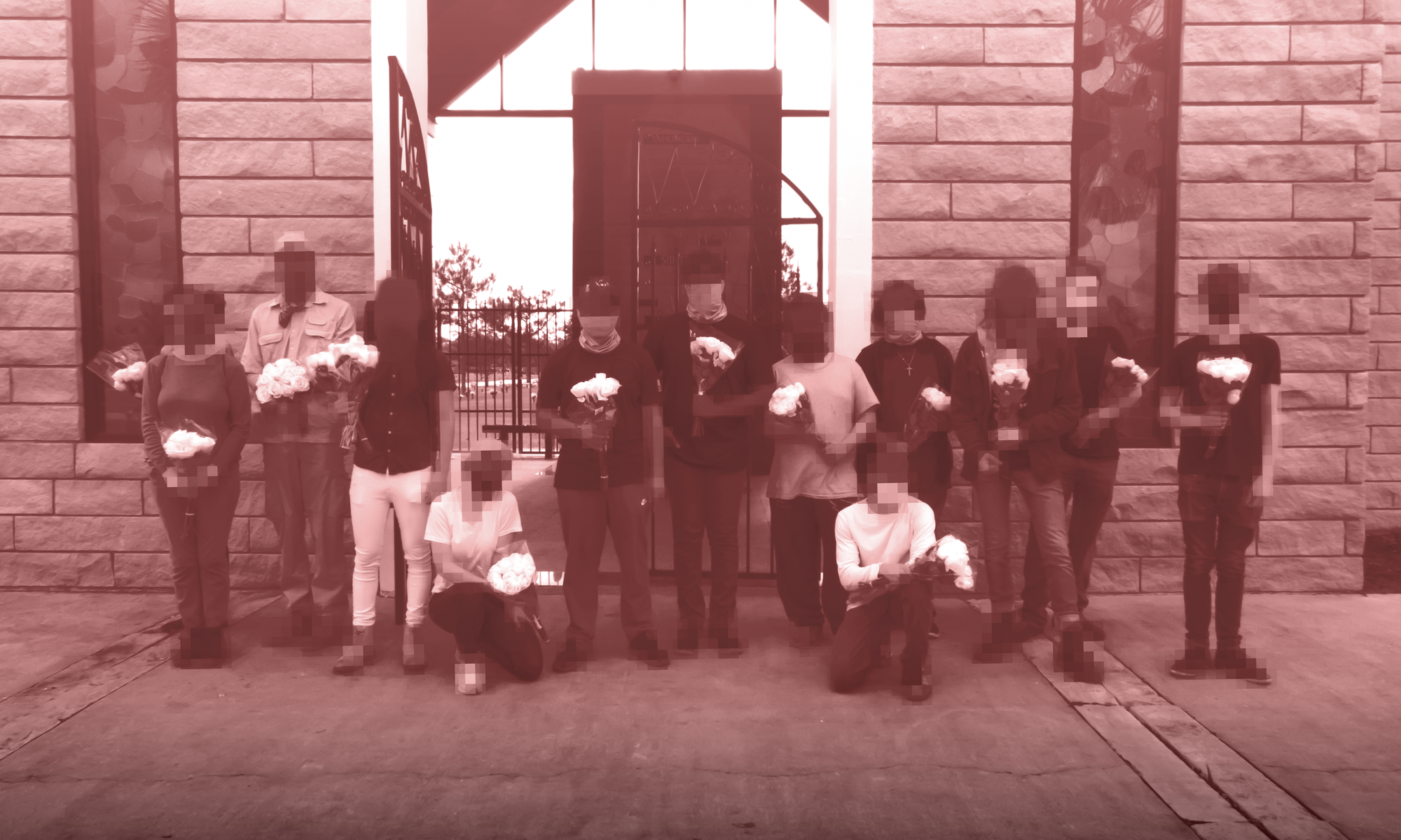 A group photo of people holding floyers in front of George Floyd's Mausoleum.